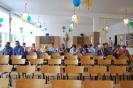 Szkoła Św. Maksymiliana w Laskach, sala spotkania, grupa z Żułowa siedzi w ustawionych w rzędach krzesłach